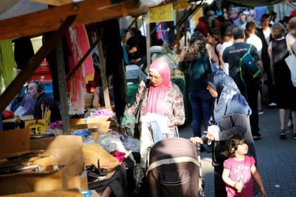 People visit a market in Berlin's Kreuzberg district, Germany, August 19, 2016. Picture taken August 19, 2016.           REUTERS/Axel Schmidt