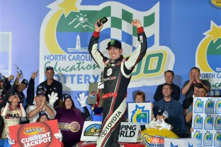 Kyle Busch, driver of the #51 Toyota Care Toyota, celebrates in Victory Lane after winning the NASCAR Camping World Truck Series North Carolina Education Lottery 200 at Charlotte Motor Speedway on May 17, 2013  Photo - Drew Hallowell/Getty Images