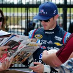 Kasey Kahne, driver of the #5 Farmers Insurance Chevrolet, signs autographs for fans during practice for the NASCAR Sprint Cup Series Oral-B USA 500 at Atlanta Motor Speedway on August 29, 2014 Photo - Jeff Curry/Getty Images