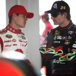 Kyle Larson and Jeff Gordon chatting with each other at Homestead in November 2013 Photo - Pat Carter/AP