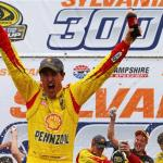Joey Logano, driver of the #22 Shell-Pennzoil Ford, celebrates in victory lane after winning the NASCAR Sprint Cup Series Sylvania 300 at New Hampshire Motor Speedway on September 21, 2014 Photo - Jonathan Ferrey/Getty images
