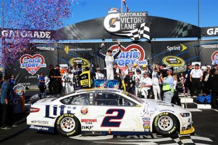 Brad Keselowski, driver of the #2 Miller Lite Ford, celebrates in victory lane after winning the NASCAR Sprint Cup Series MyAFibStory.com 400 at Chicagoland Speedway on September 14, 2014  Photo - Jerry Markland/Getty Images