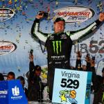 Kyle Busch driver of the No. 54 Monster Energy Toyota celebrates in Victory Lane after winning the Nationwide Series race at Richmond on September 5, 2014 Photo - Brian Lawdermilk/Getty Images