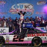 Brad Keselowski, driver of the #22 Discount Tire Ford, celebrates in Victory Lane after winning the NASCAR Nationwide Series Drive For The Cure 300 presented by Blue Cross Blue Shield of North Carolina at Charlotte Motor Speedway on October 10, 2014 Photo - Jerry Markland/Getty Images