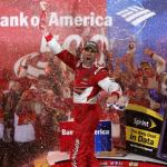 Kevin Harvick, driver of the #4 Budweiser Chevrolet, celebrates in Victory Lane after winning the NASCAR Sprint Cup Series Bank of America 500 at Charlotte Motor Speedway on October 11, 2014 Photo - Sarah Glenn/Getty Images
