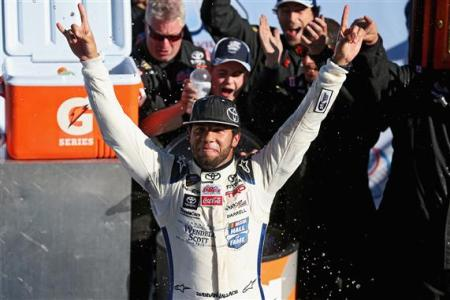 Darrell Wallace, Jr., driver of the #34 2015 NASCAR Hall of Fame Inductee Wendell Scott Toyota, celebrates in Victory Lane after winning the NASCAR Camping World Truck Series Kroger 200 at Martinsville Speedway on October 25, 2014 Photo - Sarah Glenn/Getty Images