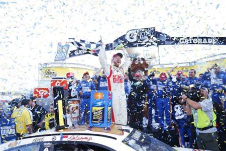 Dale Earnhardt Jr., driver of the #88 National Guard Chevrolet, celebrates in Victory Lane after winning during the NASCAR Sprint Cup Series Goody's Headache Relief Shot 500 at Martinsville Speedway on October 26, 2014  Photo - Robert Laberge/Getty Images