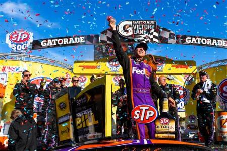 Denny Hamlin, driver of the #11 FedEx Express Toyota, celebrates in Victory Lane after winning the NASCAR Sprint Cup Series STP 500 at Martinsville Speedway on March 29, 2015 Photo - Alex Goodlet/Getty Images