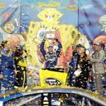 Jimmie Johnson, driver of the #48 Lowe's Chevrolet, celebrates with the trophy in Victory Lane after winning the NASCAR Sprint Cup Series SpongeBob SquarePants 400 at Kansas Speedway on May 9, 2015 Photo - Jerry Markland/Getty Images