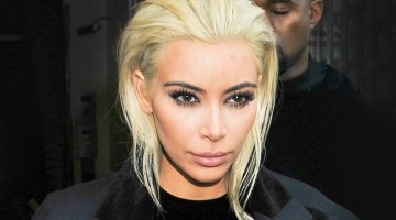 Kim Kardashian shows off her newly platinum blonde locks as she leaves her Paris hotel accompanied by husband Kanye West and mom Kris Jenner on March 5, 2015. INF Photo