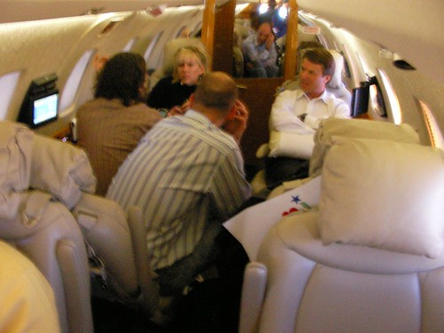 Rielle Hunter sitting next to him)