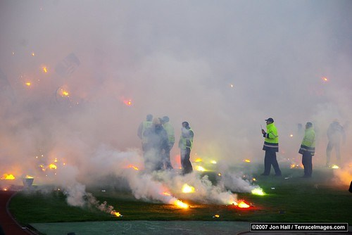 Flares on the pitch at the Partizan end