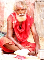 Mendicant outside the Kizhaperumpallam temple