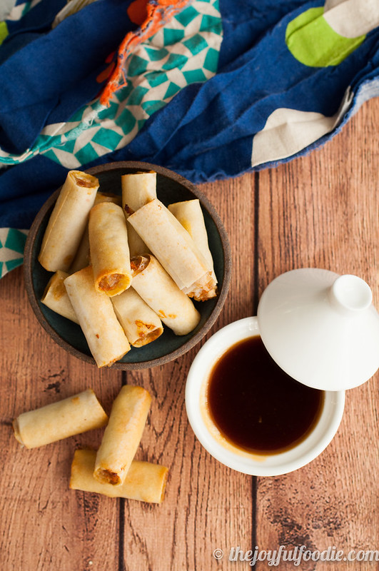 Easy Filipino lumpia shanghai - baked, not fried, and served alongside a spicy passion fruit sweet and sour dipping sauce.