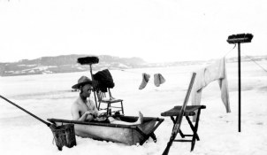 Crew member of the St. Roch having a bath in the Arctic