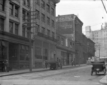 1914 photo of the McPherson Building at 300 block Water Street. This building survives today, but its dramatic cornice does not. COV Archives