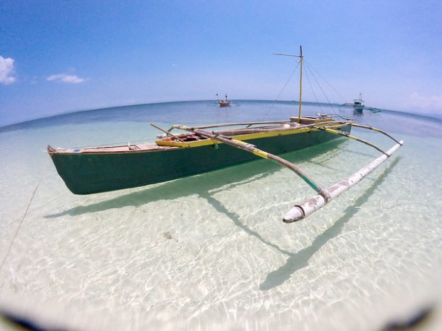 Bangka and curved earth. Paliton Beach, Siquijor