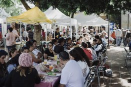 A medley of locals gathers under a tree for shade from the hot Oaxacan sun to enjoy a bite and drink with their friends and loved ones. The ambience can't really be expressed in a photograph. Unseen and unheard are an accordion player and the chatter of p