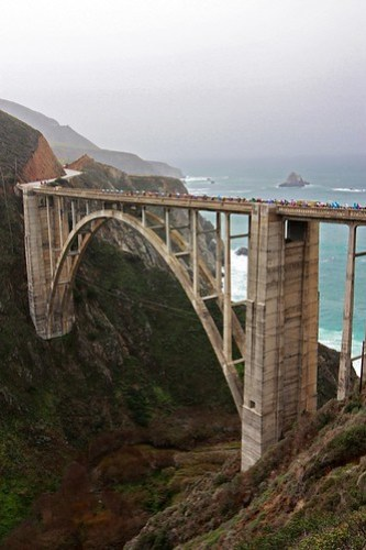 The peloton crosses Bixby Bridge