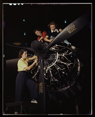 The careful hands of women are trained in precise aircraft engine installation duties at Douglas Aircraft Company, Long Beach, Calif. (LOC)