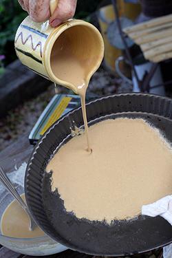 pouring socca batter