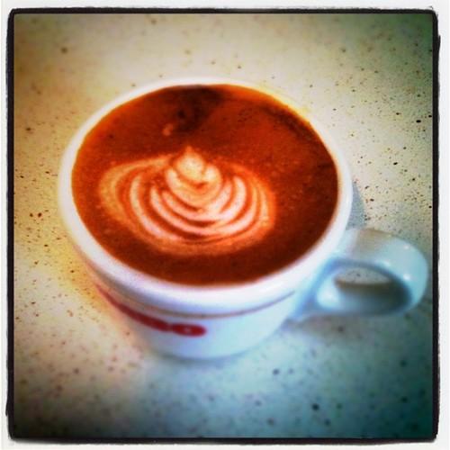 Piccolo in an espresso cup by samfreney