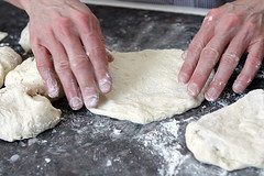 forming pizza dough rounds