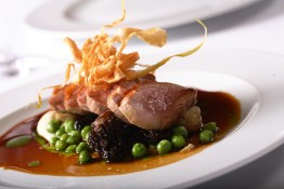 roasted Polderside Farm duck breast with morels, peas and parsnip crisps