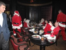 Sid Cross looks on at a Santa Claus convention in Gotham