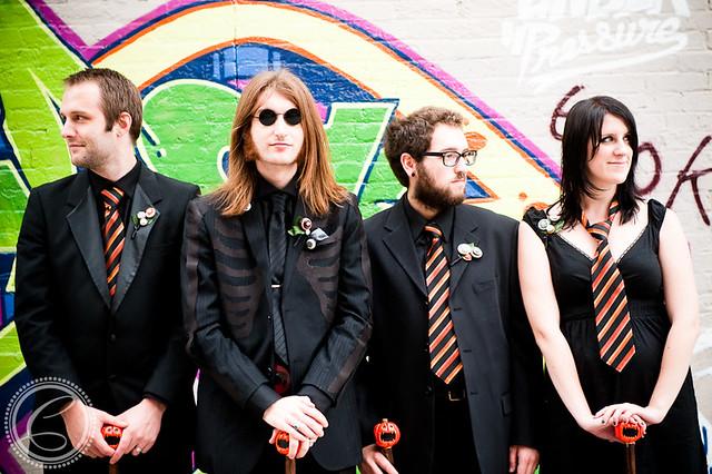 Alex (as John Lennon?) and his groomsmen/girl
