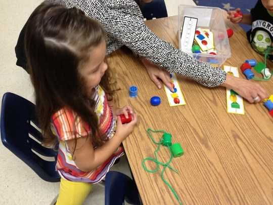 stringing beads at kindercare