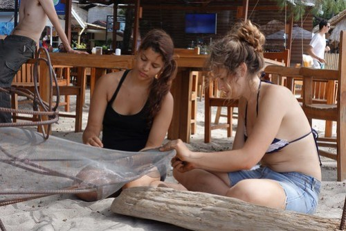 Rama and Arabella fitting a fine mesh to Jamie's tongue, which would soon carry a Gili Eco Trust implant