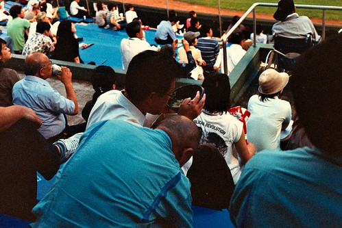 Man eating noodles in the baseball park, Hiroshima, Japan