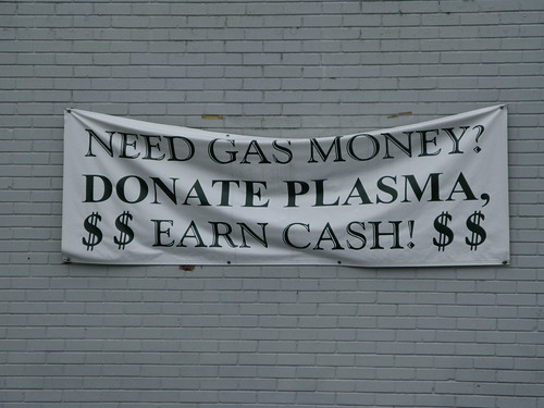 Sign on building: Need Gas Money? Donate Plasma. $$ Earn Cash $$