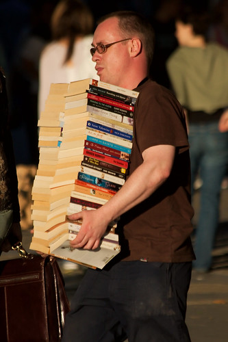 """Carrying Books"" by garryknigh via Flicker. See below for license."