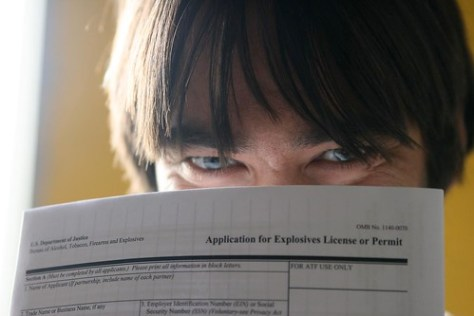 creepy guy looking over a application form