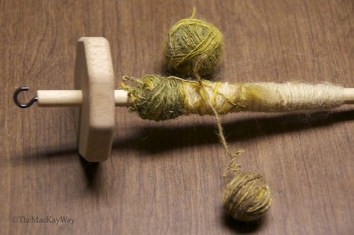 Rolling the single ply yarn into balls.