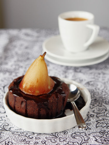 Chocolate and pear muffins with chocolate syrup