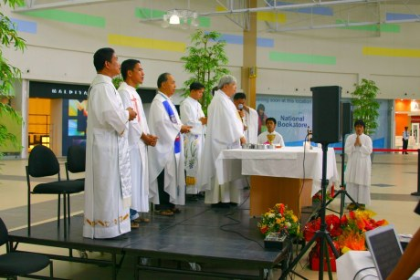Bishop Dinualdo Gutierrez, DD concelebrating a mass with 7 other priests at the Atrium of Robinsons Place- GenSan on September 29, 2009.