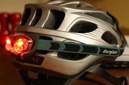 Red LED headlamp on bike helmet