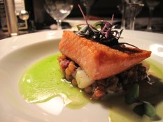Pacific salmon (perfect) with wheatberry, potato and smoked pork hash on parsley broth