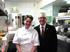 Chef Andrea Carlson and John Bishop in the kitchen