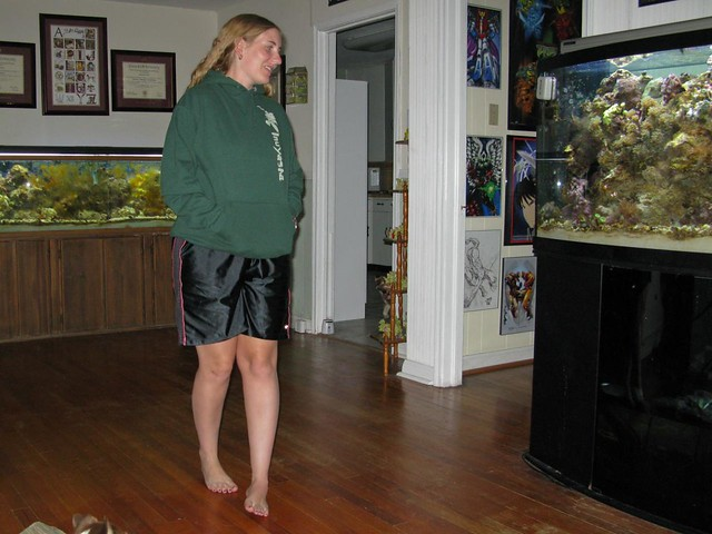 Weird, Sarah is actually smiling by looking at the fish tank . that