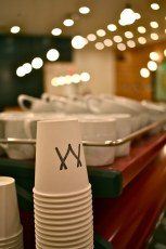 Close up of Matchstick's branded to go cups