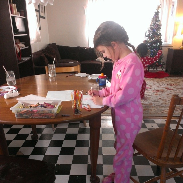 Drawing her pictures for Santa. :-)