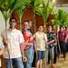 UH Hilo Hawaiian language students and high schools students from Nāwahīokalaniʻōpuʻu laboratory school holding ti leaves, symbolizing spiritual blessings for the dedication ceremonies.