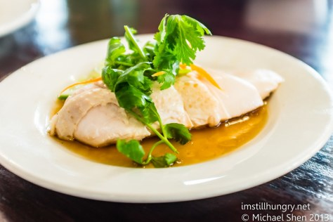 Hainan Chicken Rice Half Served boneless chicken steamed to perfection served with rice cooked in aromatic chicken stock