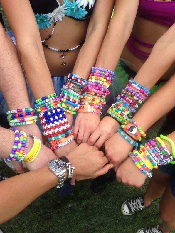 Bryanboy's Rolex watch and Hermes bracelet with Raver kandi kids bracelets