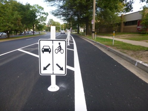 Arlington installs its first protected bike lanes for Motor city pawn shop on 8 mile and hayes