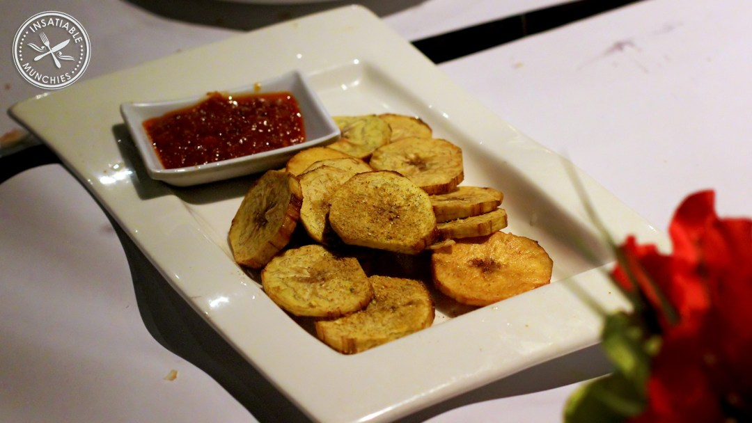 Plantain, marinated in ginger and red chilli, and deep fried. With a tomato based dipping sauce.